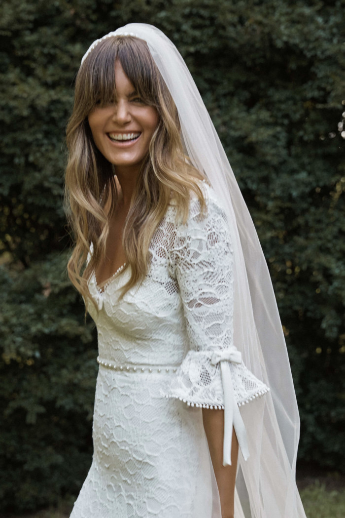 Bride with bangs wearing the Odette Headband Veil & the Frenchie gown