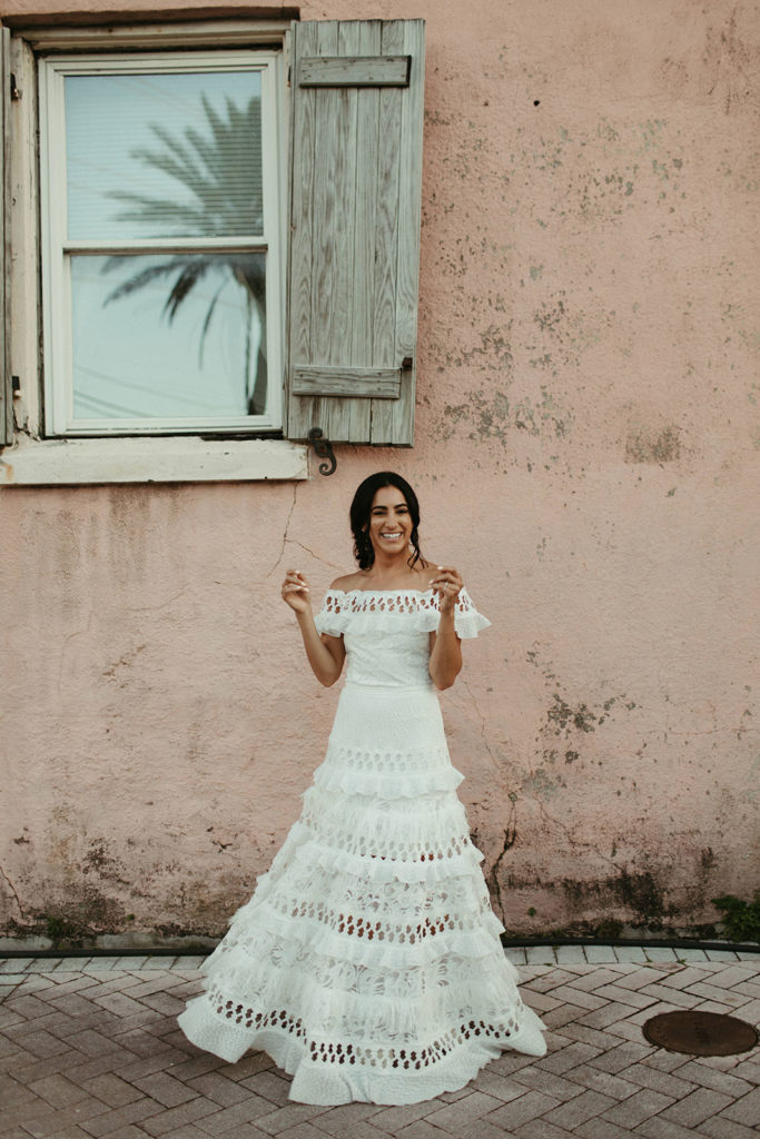 Brunette bride wearing Grace Loves Lace Coco Gown laughing