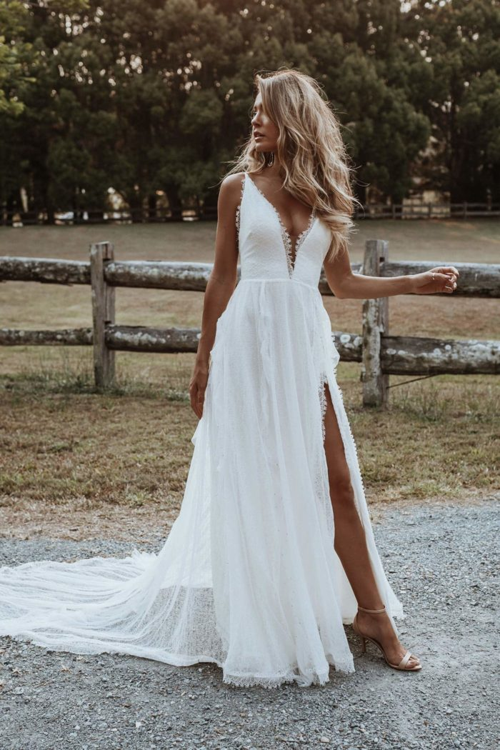 Bride wearing Grace Loves Lace Song Gown looking to the side