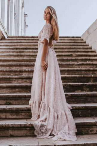 Back shot of bride wearing Grace Loves Lace Capri Gown standing on stairs