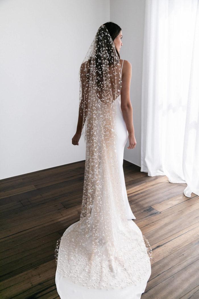 Back shot of brunette bride wearing Grace Loves Lace Menha Veil