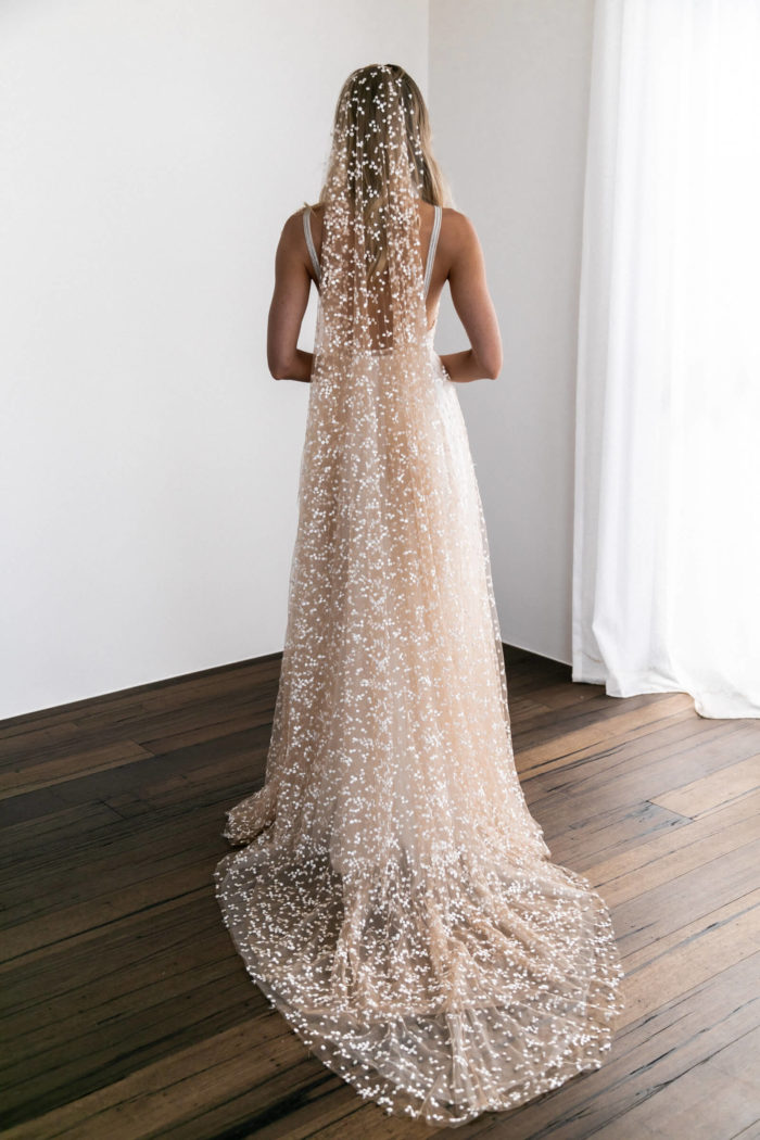 Back shot of blonde bride wearing Grace Loves Lace Menha Veil