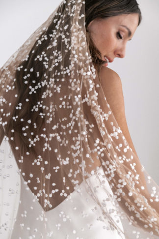 Close-up of bride wearing Grace Loves Lace Menha Veil