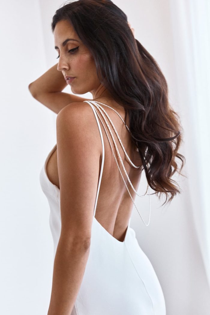 Side shot of bride wearing Grace Loves Lace Lucine Backpiece with hand in hair