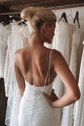 Bride wearing Grace Loves Lace Bandera Backpiece with hand on hip