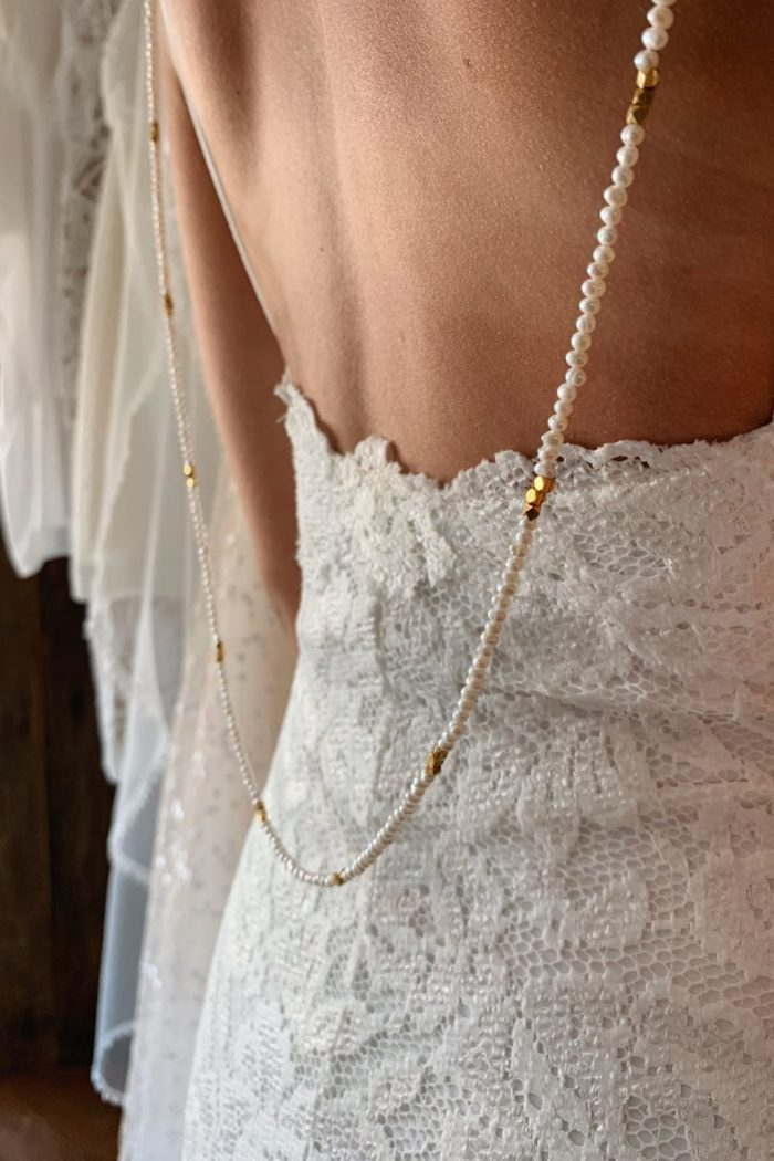 Close-up of bride wearing Grace Loves Lace Bandera Backpiece