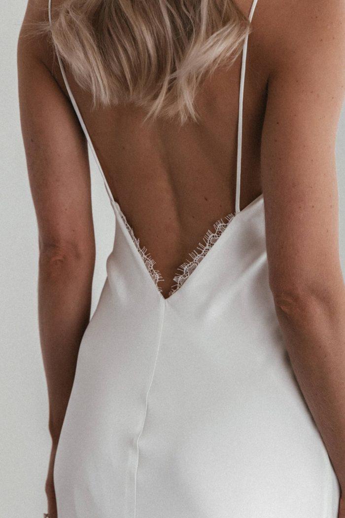 Back shot of bride wearing Grace Loves Lace Summer Eyelash Gown