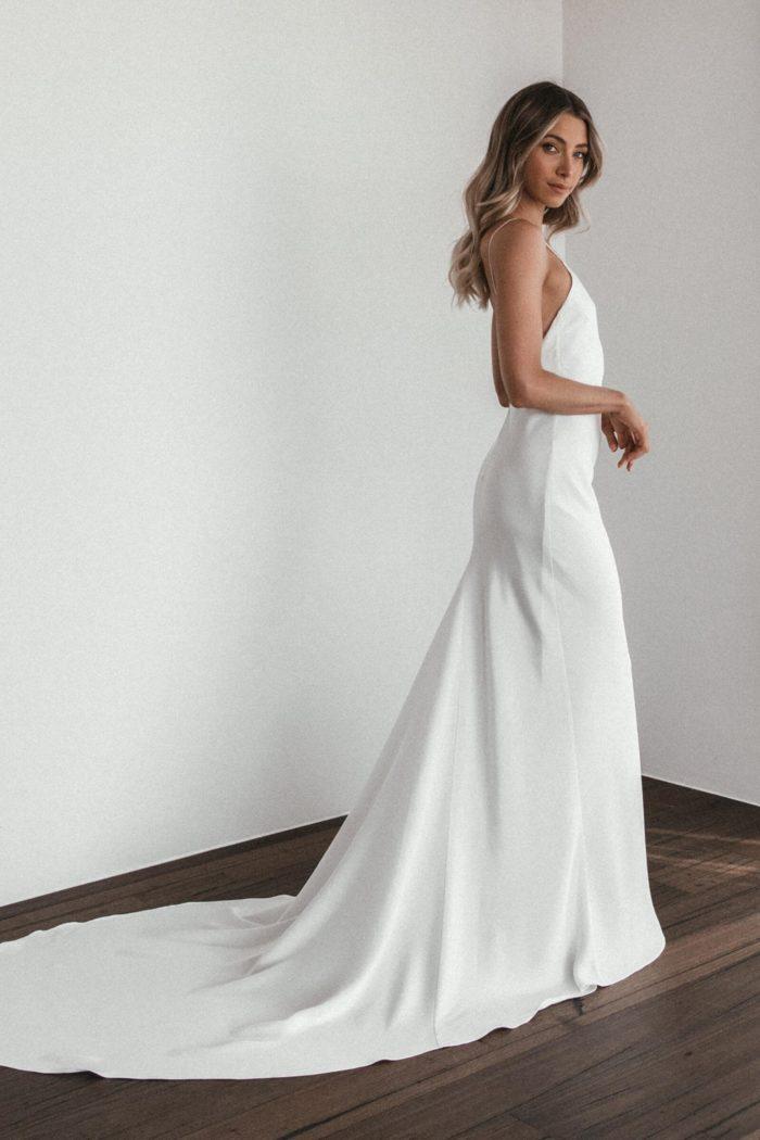 Side shot of bride wearing Grace Loves Lace Summer Eyelash Gown