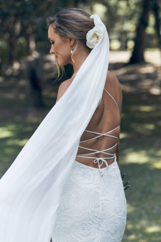 Mid back shot of bride wearing Grace Loves Lace Gabriela Veil in a forest