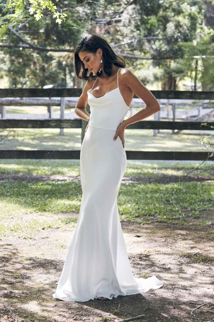Bride wearing Grace Loves Lace Honey Silk Gown with hands on hips