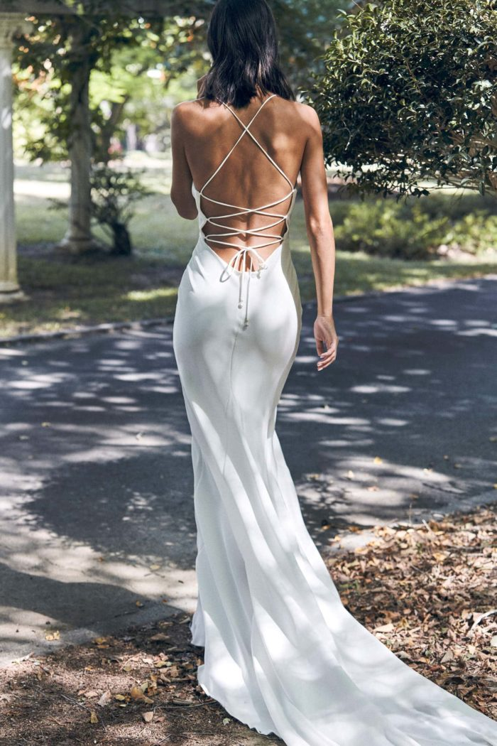 Back shot of bride wearing Grace Loves Lace Honey Silk Gown