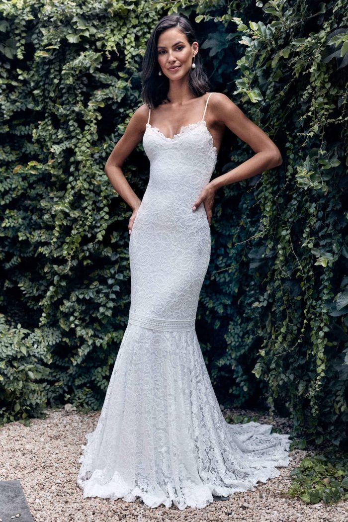 Bride wearing Grace Loves Lace Hart Gown with hands on hips