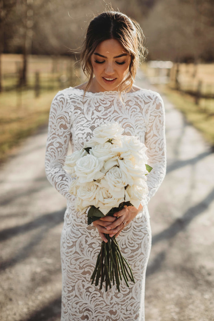 Bride wearing Grace Loves Lace Orla Gown holding bouquet