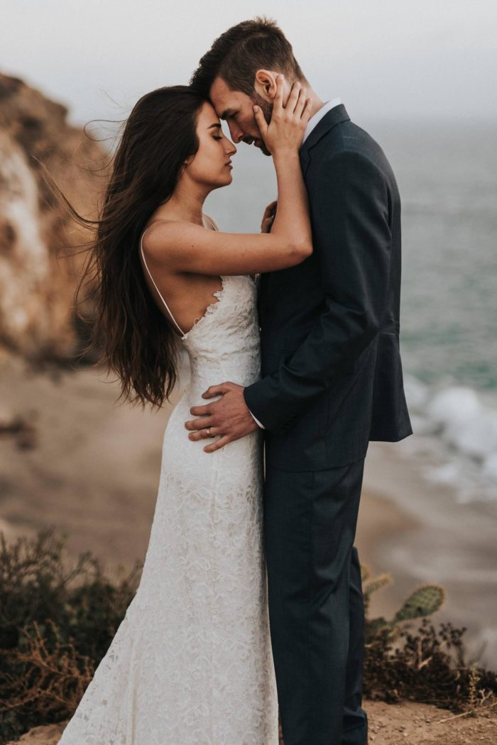 Brunette bride wearing Grace Loves Lace Mia Gown embracing groom