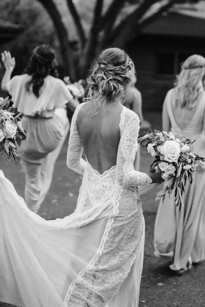 Black and white shot of bride wearing Grace Loves Lace Inca Gown holding bouquet