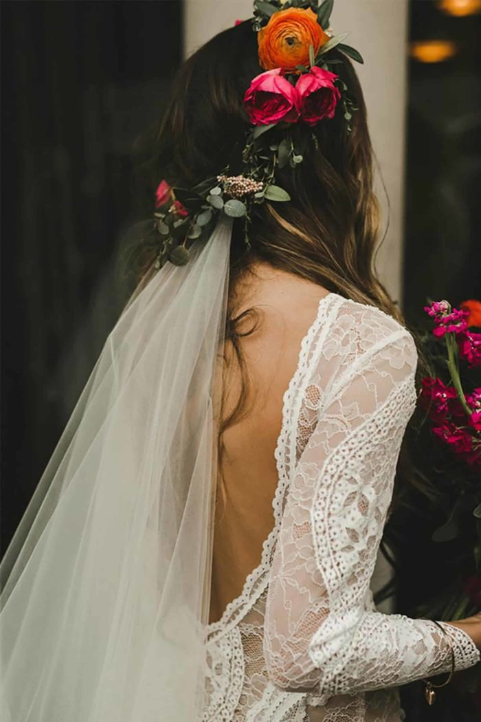Back shot of bride wearing Grace Loves Lace Inca Gown holding bouquet