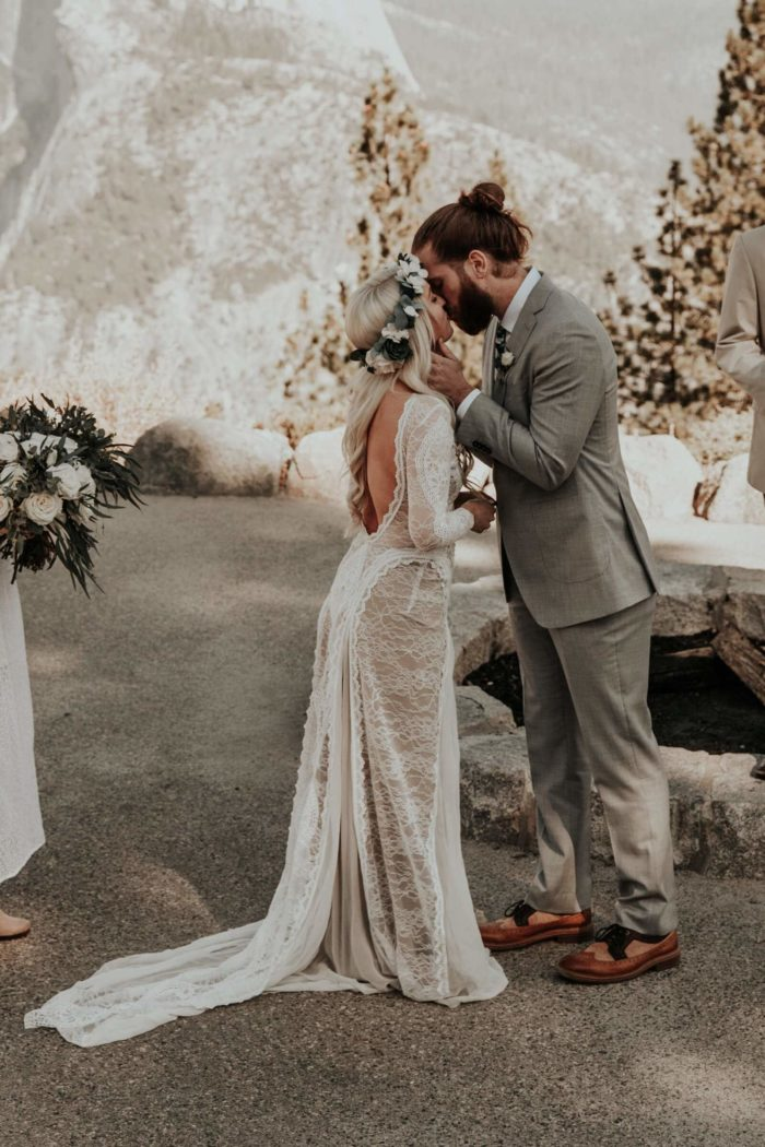 Bride wearing Grace Loves Lace Inca Gown kissing groom
