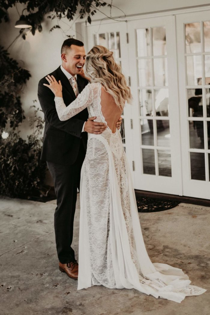 Bride wearing Grace Loves Lace Inca Gown dancing with groom