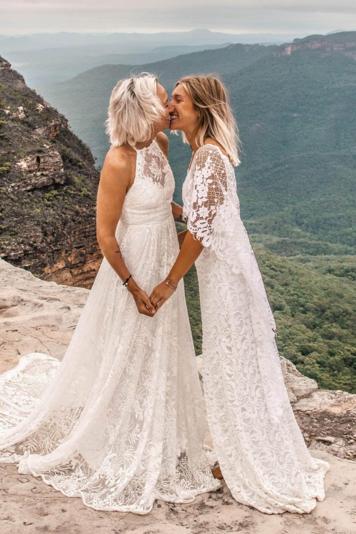 Blonde bride wearing Grace Loves Lace Harri Gown kissing bride