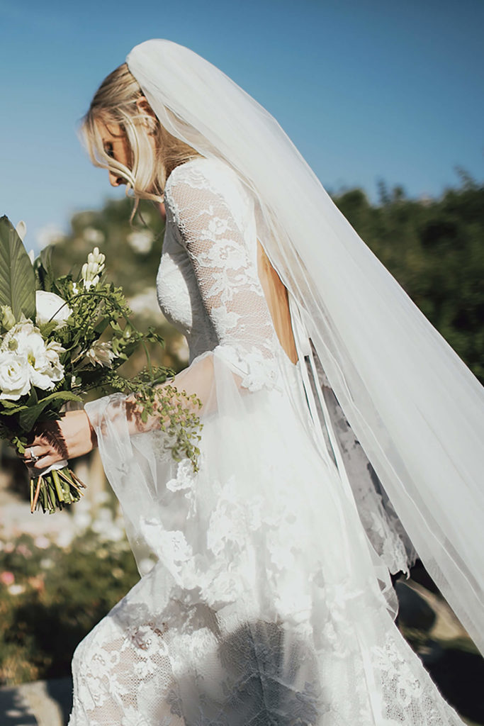 Blonde bride wearing Grace Loves Lace Francis Gown holding bouquet