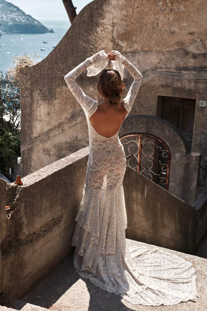 Back shot of bride wearing Grace Loves Lace Farrow Gown with arms above head