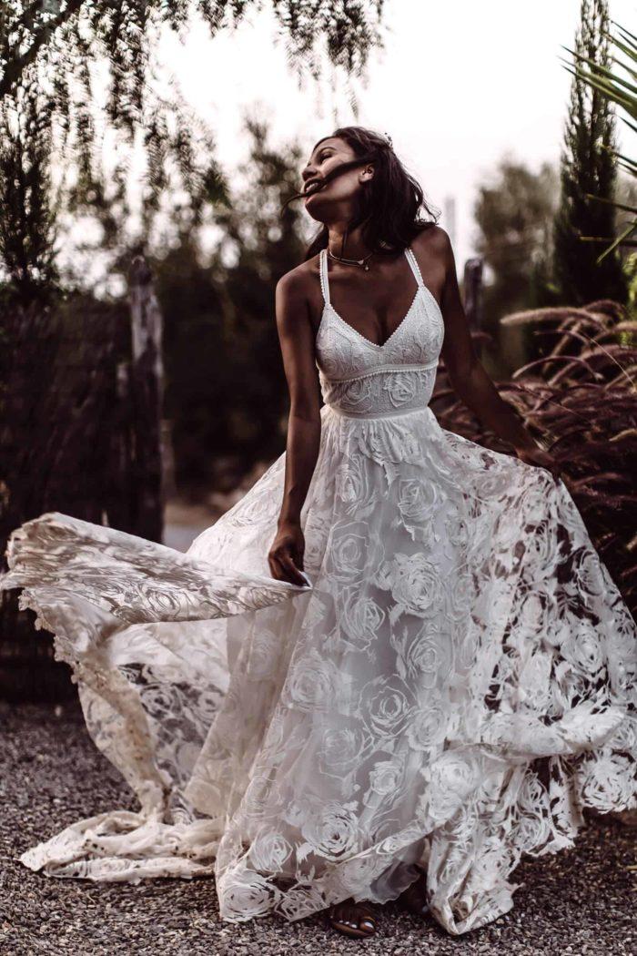 Brunette bride wearing Grace Loves Lace Megan Gown on garden path