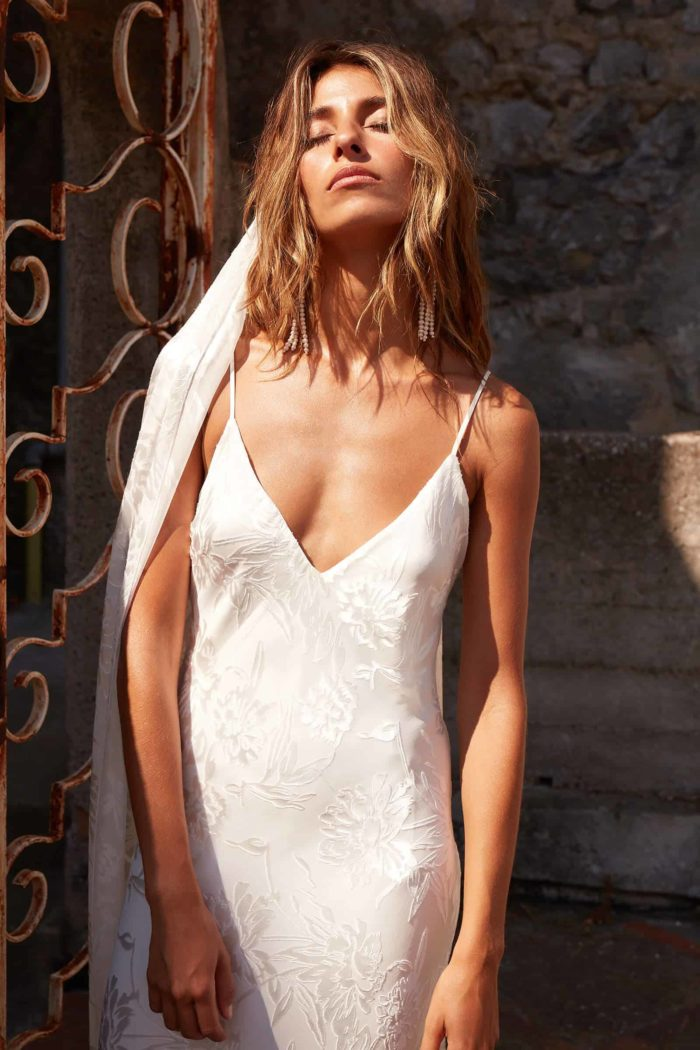 Brunette bride wearing Grace Loves Lace Loyola Gown with eyes closed