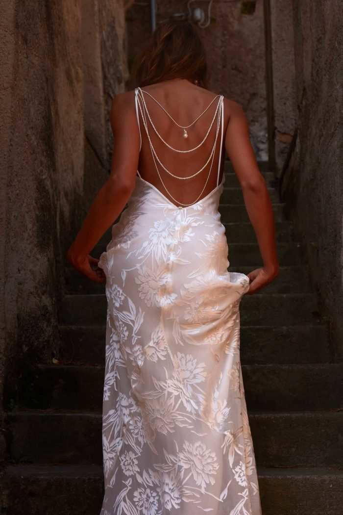 Back shot of bride wearing Grace Loves Lace Loyola Gown walking up stairs