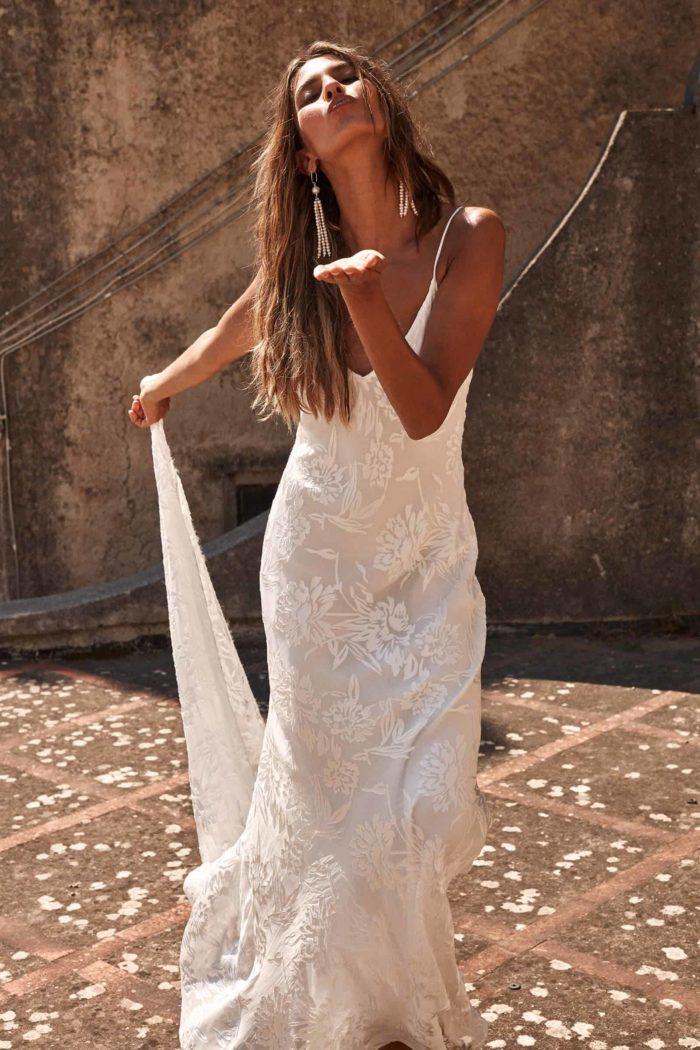 Brunette bride wearing Grace Loves Lace Loyola Gown blowing a kiss
