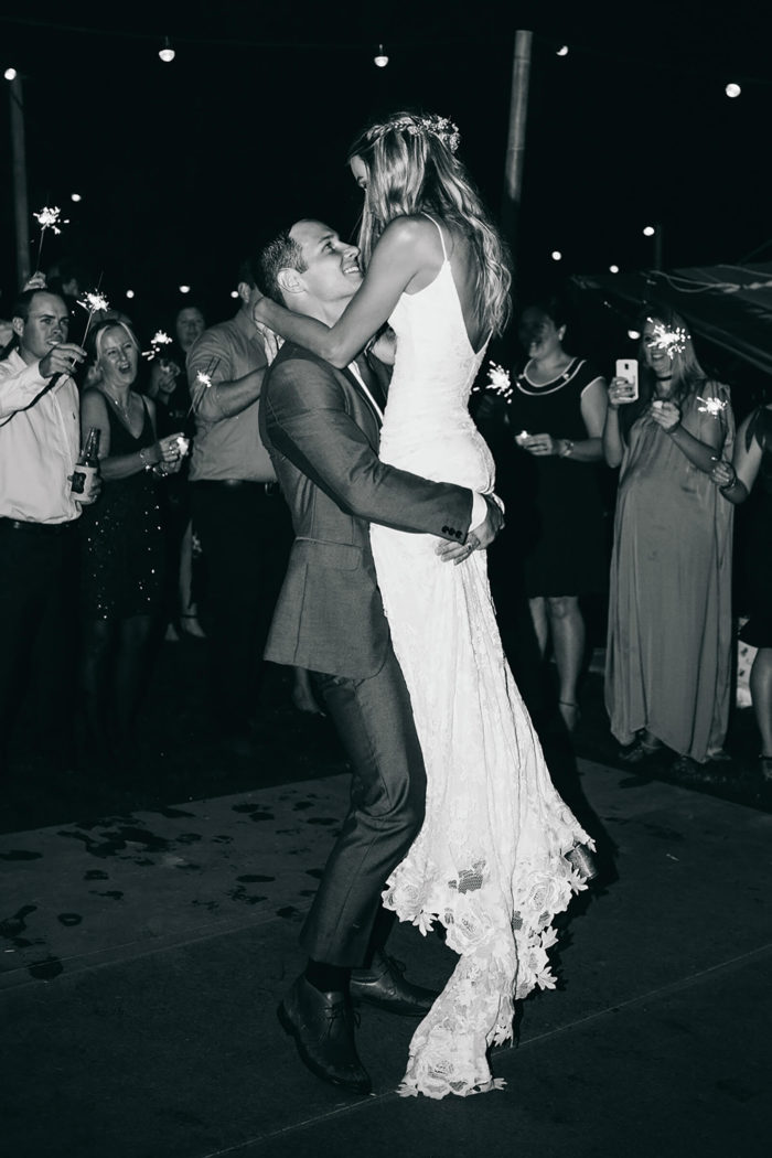 Black and white shot of bride wearing Grace Loves Lace Lottie Gown dancing with groom
