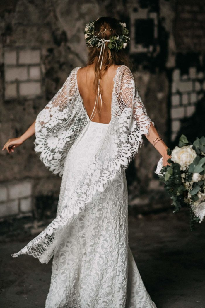 Back shot of bride wearing Grace Loves Lace Verdelle 2.0 Gown holding bouquet