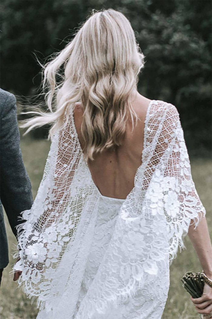 Back shot of bride wearing Grace Loves Lace Verdelle 2.0 Gown