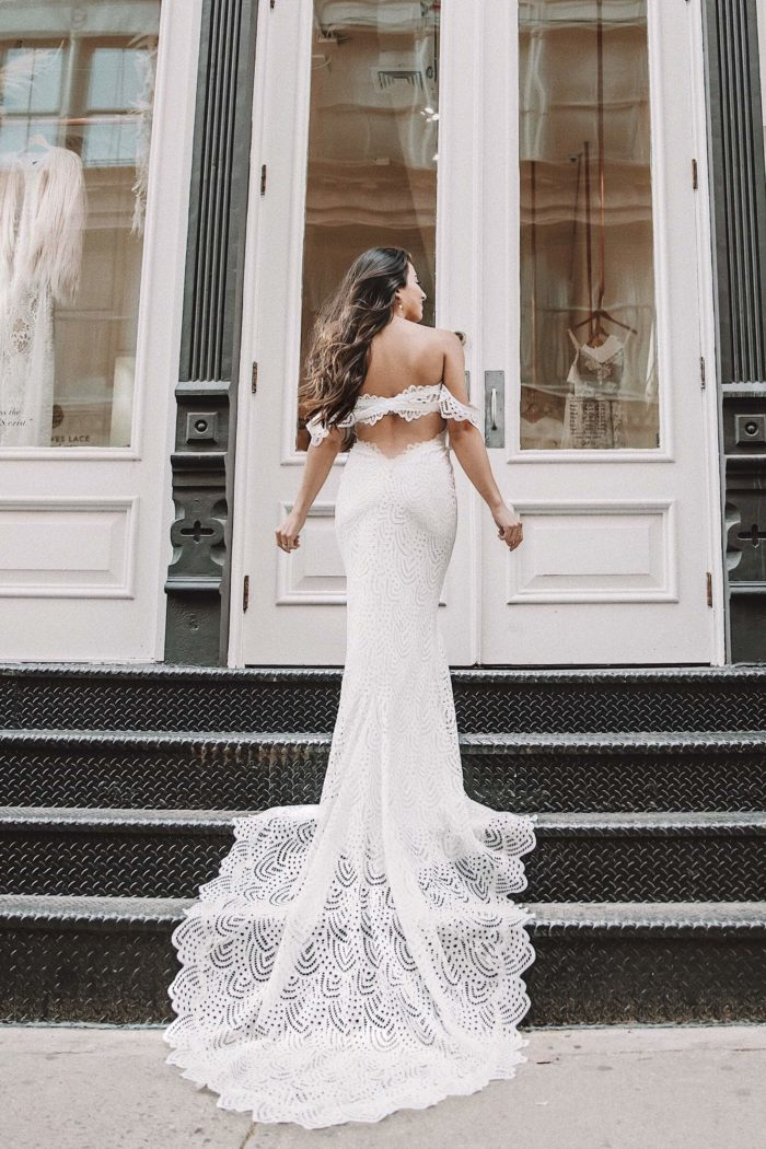 Back shot of bride wearing Grace Loves Lace Paloma Gown walking up stairs