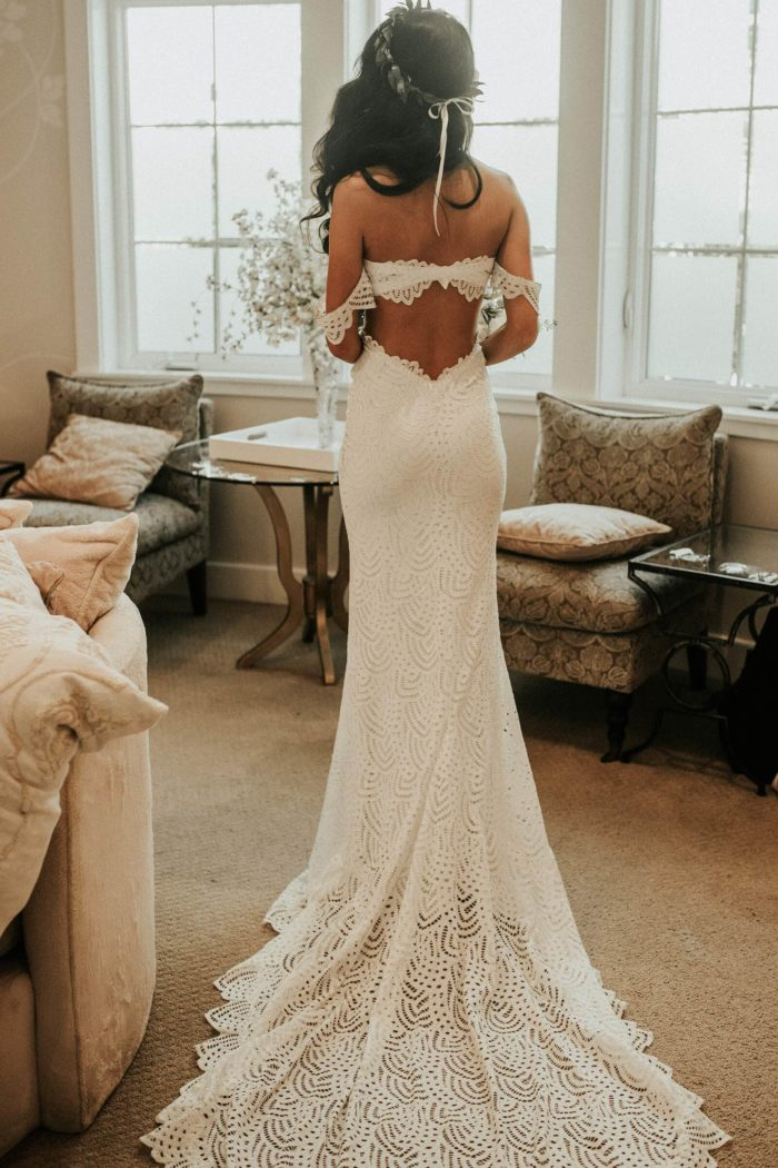 Back shot of brunette bride wearing Grace Loves Lace Paloma Gown and flower crown