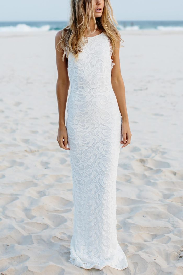 Blonde bride wearing Grace Loves Lace Nia 2.0 Gown on beach