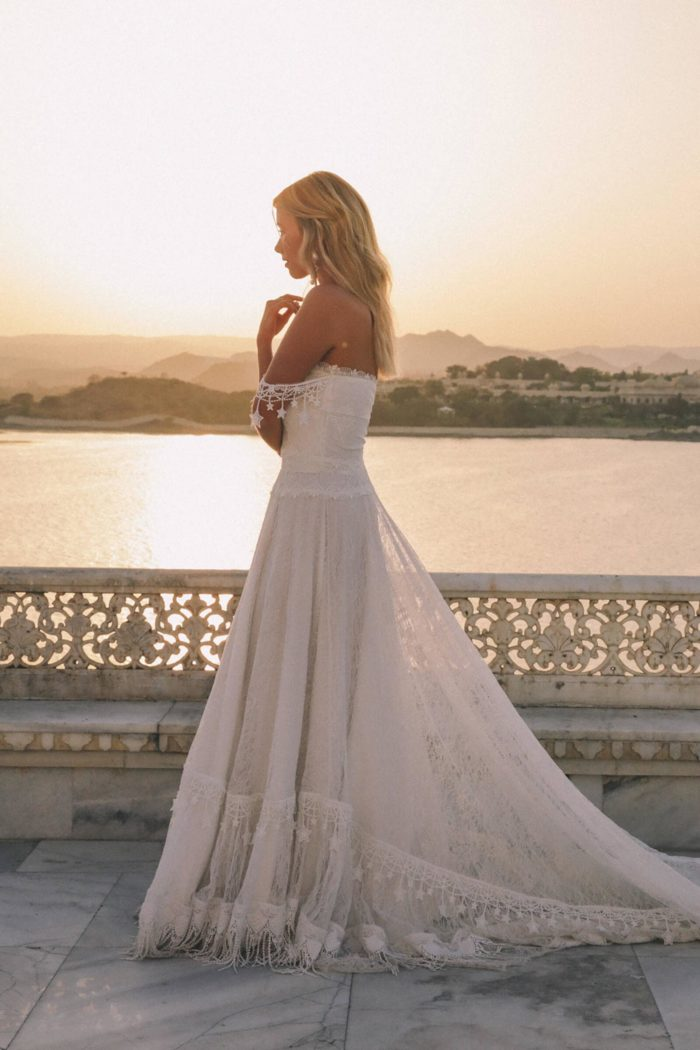 Side shot of bride wearing Grace Loves Lace Fabienne 2.0 Gown