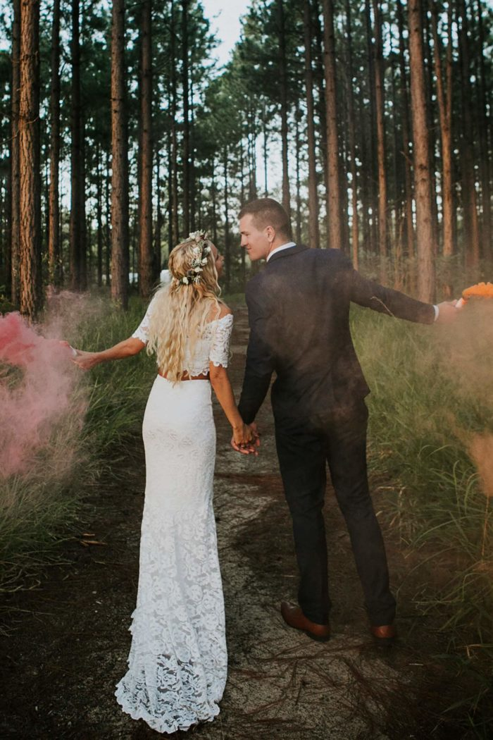 Blonde bride wearing Grace Loves Lace Everly Gown walking with groom