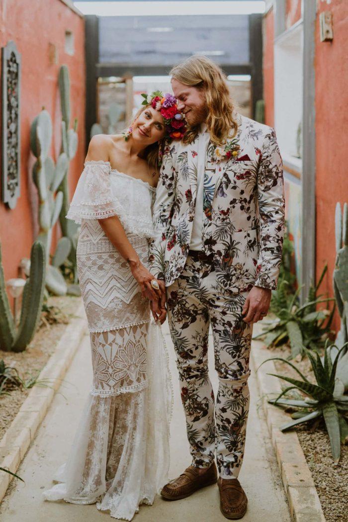 Brunette bride wearing Grace Loves Lace Emanuela Gown leaning on groom's shoulder