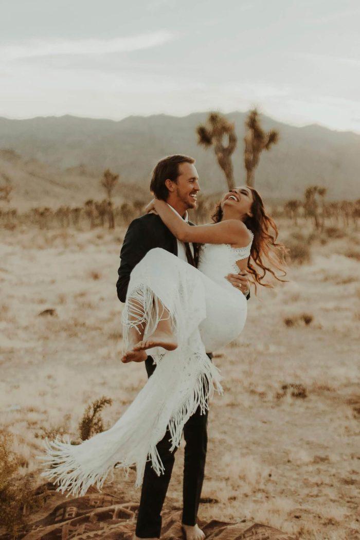 Brunette bride wearing Grace Loves Lace Edie Gown being held by groom