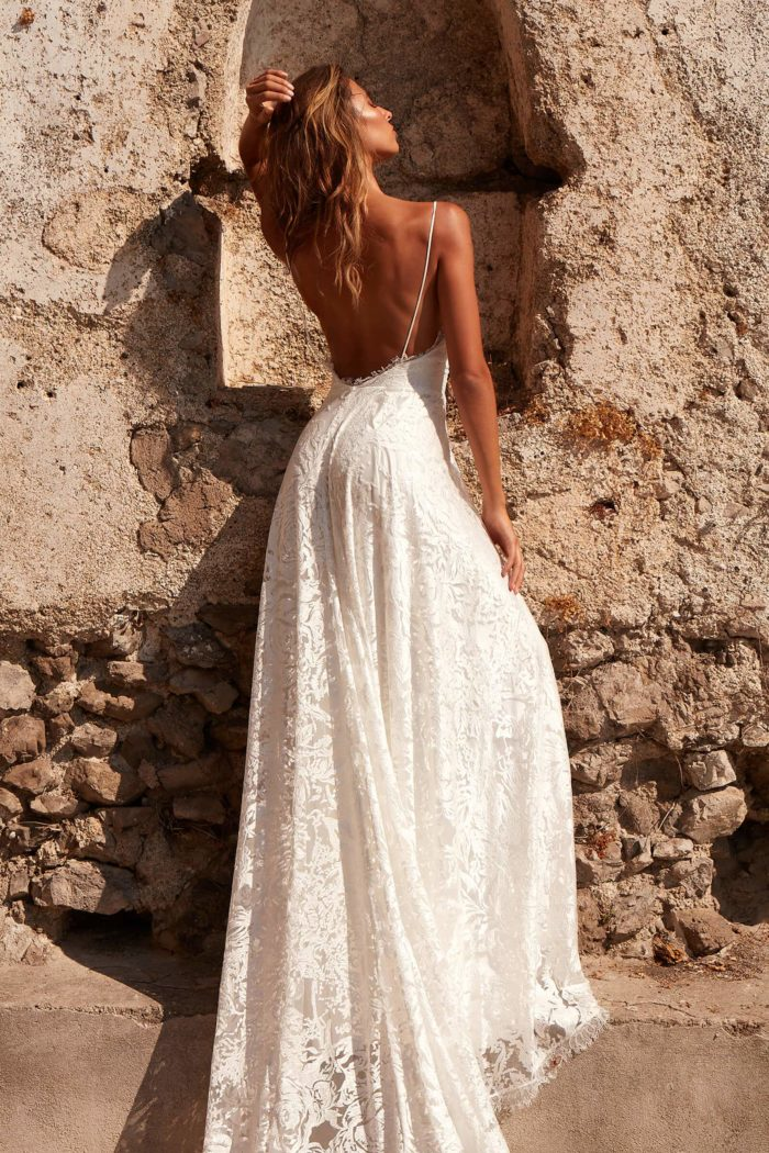 Back shot of brunette bride wearing Grace Loves Lace Darling Gown