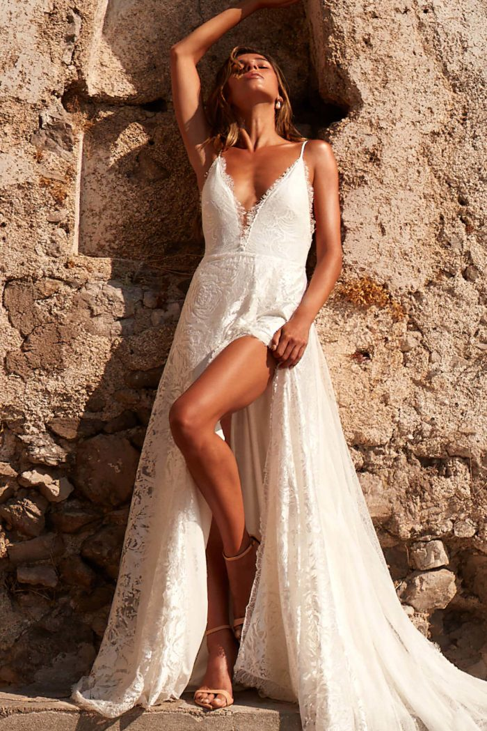 Brunette bride wearing Grace Loves Lace Darling Gown with leg showing