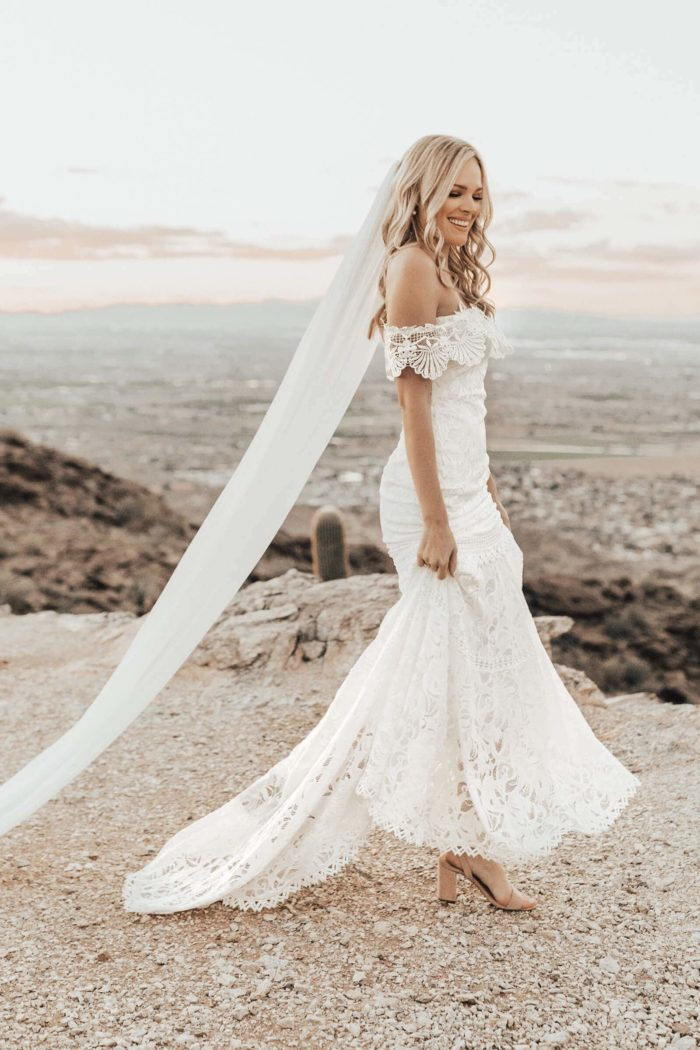 Blonde bride wearing Grace Loves Lace Cien Gown and veil