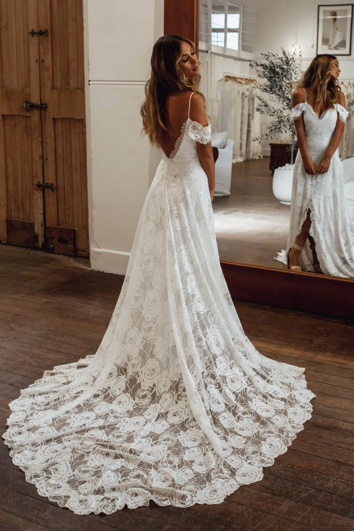 Back shot of bride wearing Grace Loves Lace Bonita Gown looking over shoulder in front of mirror