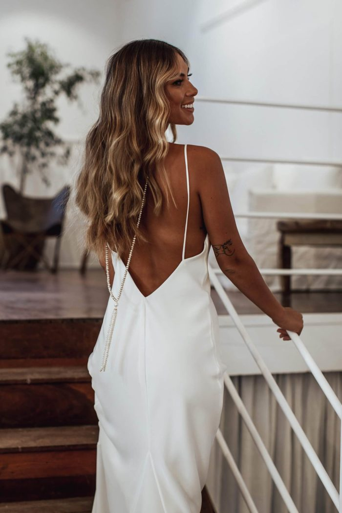 Back shot of bride wearing Grace Loves Lace Mata Backpiece on stairs