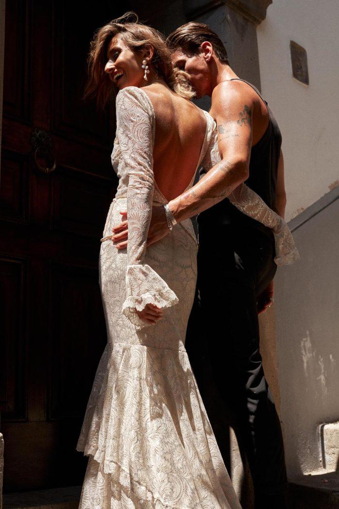 Bride wearing Grace Loves Lace Essie Earrings walking with groom