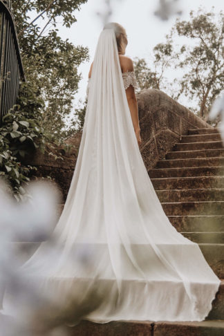 Bride wears Grace Loves Lace Gabriela Veil while ascending set of stone stairs