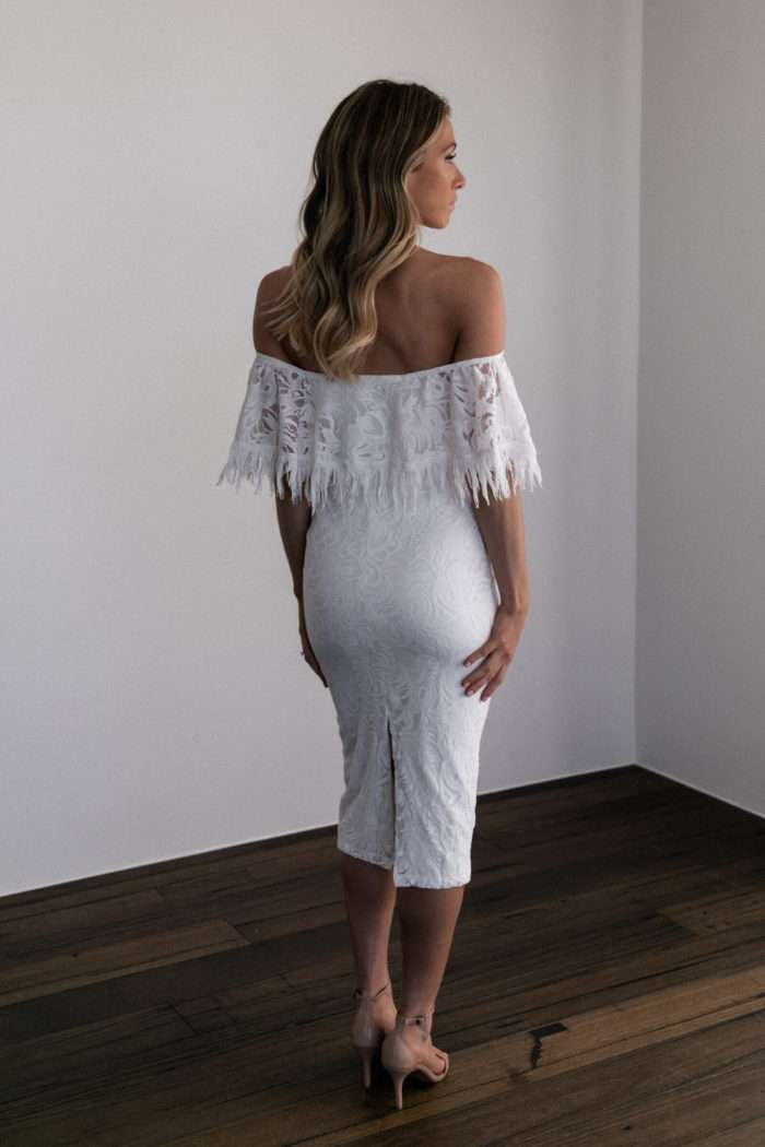 Back shot of bridesmaid wearing Grace Loves Lace Dominga Dress with Ivory Lining