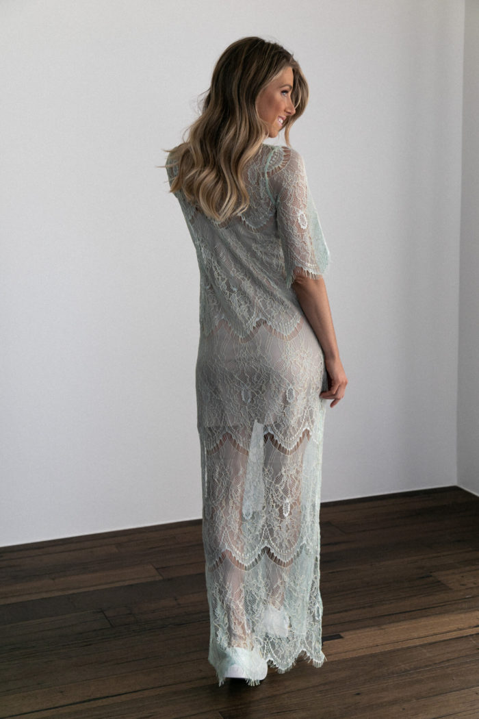 Back shot of bridesmaid wearing Grace Loves Lace Lace Maxi Dress in Peridot