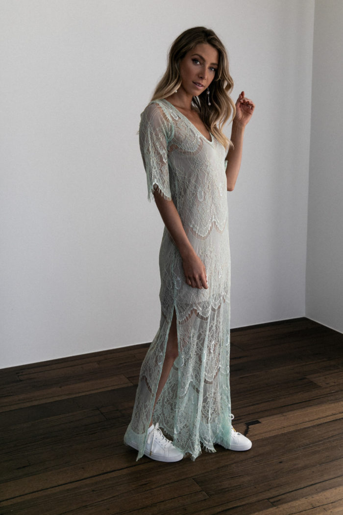 Bridesmaid wearing Grace Loves Lace Lace Maxi Dress in Peridot with white sneakers