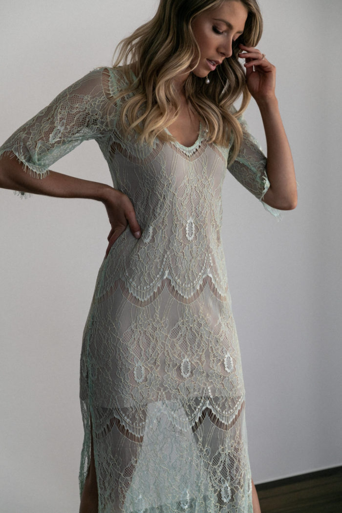 Bridesmaid wearing Grace Loves Lace Lace Maxi Dress in Peridot with hand on hip
